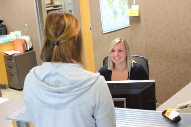 Student at Clinic Reception Desk